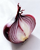 Red onion, halved, on light background