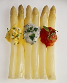 Boiled white asparagus with three different sauces