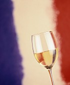 A Glass of White Wine in Front of the French Flag