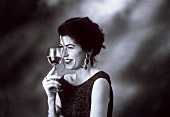 A Woman Drinking A Glass of White Wine