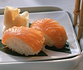 Two hand-formed salmon sushi