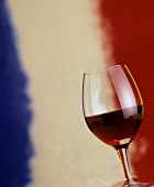 A Glass of Red Wine in Front of the French Flag