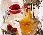 Strawberry & cranberry sorbet and mango sorbet in glasses
