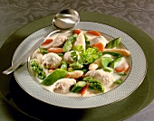 Asparagus ragout with vegetable and meat dumplings