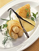 Crepe with asparagus stuffing and butter and vanilla sauce