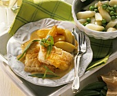 Cod fillets with tarragon sauce, potatoes, asparagus