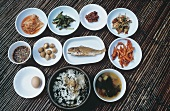 Various Korean rice, fish and vegetables dishes