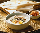 Korean rice biscuit soup with meat and vegetables