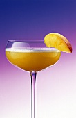 Bellini (champagne cocktail with white peaches)
