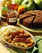 English menu with sausage, apple chutney, cheese and cake