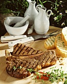 Grilled T-bone steak on wooden platter