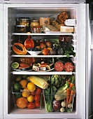 An Open Refrigerator Filled with Assorted Foods