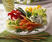 Mixed raw vegetables with herb quark dip