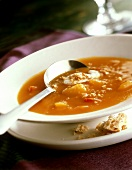 Pumpkin soup on plate with spoon