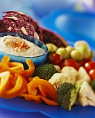 Raw vegetable pieces and a bowl of dip