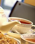 A Cup of Tea with Tea Pot and Sugar