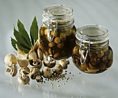Two jars of marinated button mushrooms