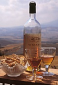 Vin Santo in glasses and bottle and Cantucci (almond biscuits)