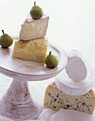 Cheese still life with various types of cheese & three pears