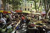 Busy market scene in Aix en Provence (France)