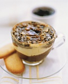 Light and dark chocolate mousse with caramel in a glass cup