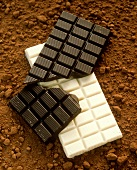 Blocks of Bittersweet Chocolate, White Chocolate Resting on Cocoa