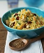 Saffron and paprika rice with nuts in a blue bowl