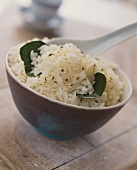 Bowl of rice with Asian spices and lemon leaves