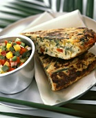 Two pieces of vegetable frittata & bowl of diced vegetables
