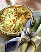 Leek quiche with bacon in quiche dish