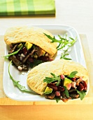 Pita breads filled with warm meat & vegetable salad (spicy)