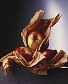 Apples in brown wrapping paper