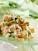 Chicken breast salad with peas and boiled ham