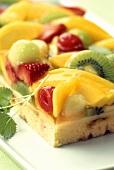 Colourful fruit tart with cake glaze