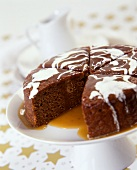Chocolate cake, pieces cut on cake plate, with syrup