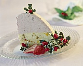 Piece of iced bombe with Christmas decoration on dessert plate