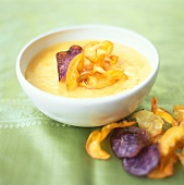 Potato and pumpkin soup with fried vegetable crisps