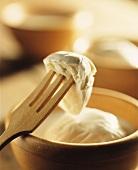 Mozzarella di Bufala in bowl and on wooden fork