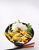 Asian vegetable stir-fry with rice in bowl