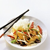 Asian vegetable stir-fry with rice on plate