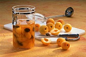 Home-made apricot brandy in glass and fresh apricots