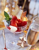 Raspberry sorbet in glass with lychees & star wafers