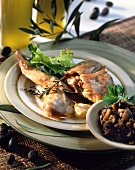 Braised rabbit with garlic and olive stuffing