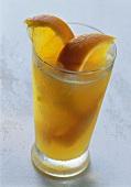 Glass of orange juice with soda, decorated with orange slices