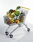 Shopping trolley filled with various foods