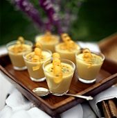Passion fruit mousse in glasses on a tray