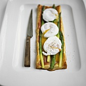 Savoury puff pastry quiche with asparagus and poached eggs