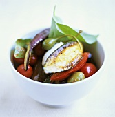 Roast vegetables in a white bowl