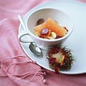 Sweet millet porridge with grapefruit, grapes & nuts