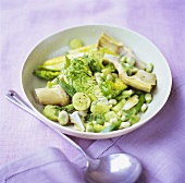 Green vegetable salad with beans, cucumber, artichokes